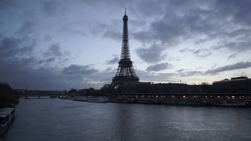 Eiffel Tower and Seine River in twilight just before sunrise with fast passing clouds. Paris, Port de Suffren, Grenelle, 7th Arrondissement. France | Shutterstock HD Video #16599877