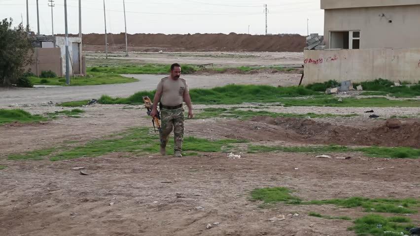 Iraq, February 2016: Iraqi, Pesh Merga sniper walking toward to camera