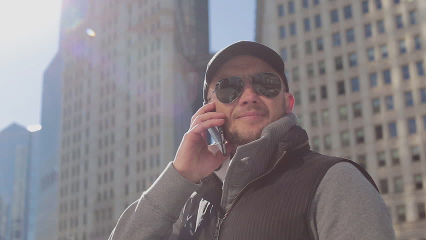 The Guy With the Phone at the Trump Skyscraper, Guy With Glasses With a Bag in Chicago Skyscrapers Beautiful , Sunny Day , the Man With the Phone Says | Shutterstock HD Video #16615564