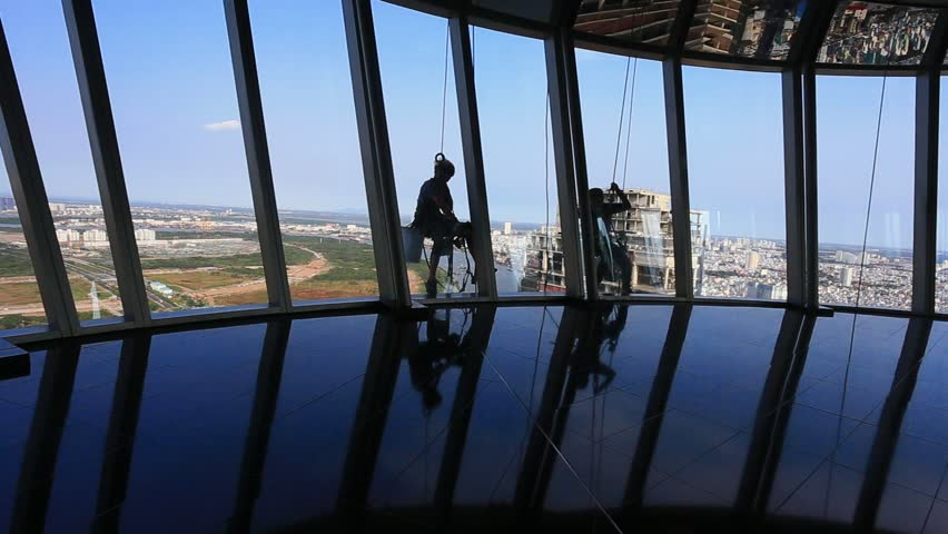 Window washers. View point from peak Betexco building. May 12,2016 - HD stock footage clip