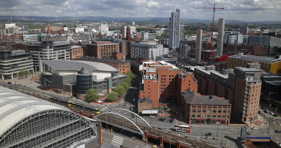 MANCHESTER, ENGLAND - MAY 25, 2015 Busy Street Cars Traffic Manchester Skyline Aerial View Metro Transportation Day ( Ultra High Definition, UltraHD, Ultra HD, UHD, 4K, 2160P, 4096x2160 )