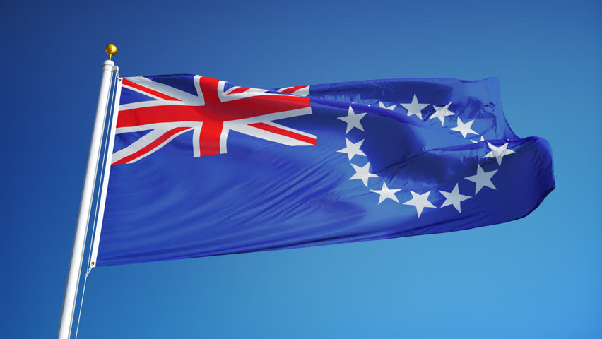 Cook Islands flag waving in slow motion against blue sky, seamlessly looped, close up, isolated on alpha channel with black and white luminance matte, perfect for film, news, digital composition - 4K stock footage clip