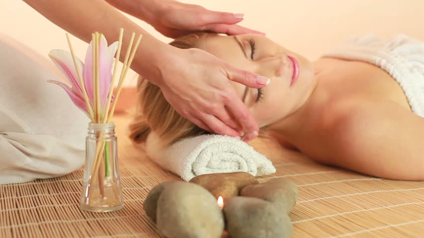 Spa Treatment Head massage high angle view with hands of female masseuse. - HD stock video clip