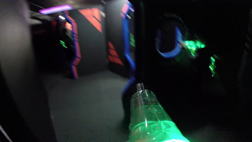 MOSCOW - DEC 13, 2014: (FPV) People with guns in Q-zar of amusement park COSMIC-Capitol (child on right with MR). Q-Zar - laser tag. Refers to arena, high-speed type (rate - up to 6 shots per second)