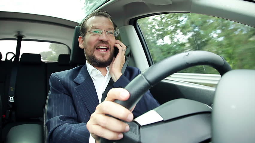 Happy Business Man Talking On The Phone While Driving Car ...