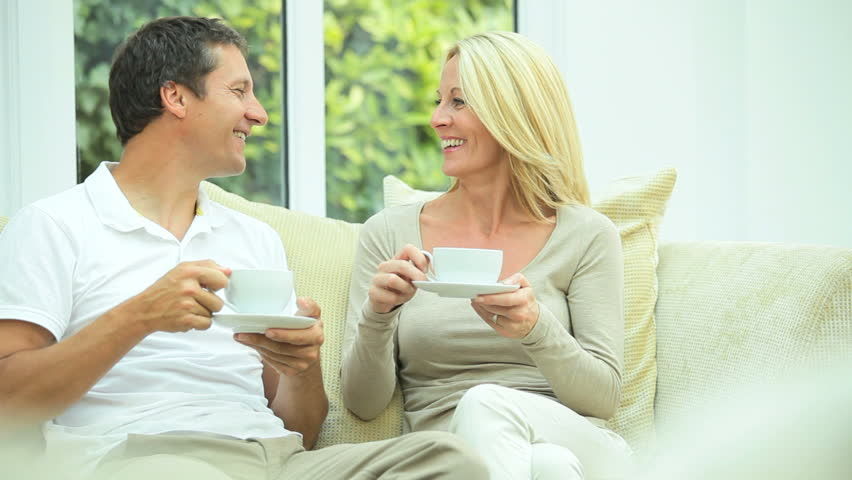Attractive Couple Relaxing with Cup of Coffee - HD stock footage clip