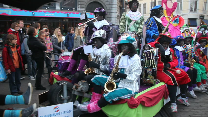 THE HAGUE, HOLLAND - NOVEMBER 12 - The Santa Claus (Sinterklaas) parade with a brass band arrives on November 12, 2011 in The Hague, Holland. Sinterklaas is a traditional festival in Holland - HD stock footage clip