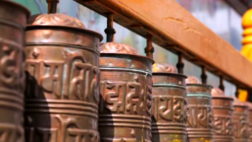 Spinning prayer wheels at the Boudhanath Stupa, Kathmandu, Nepal. Boudhanath Stupa (Bodnath Stupa) is the largest stupa in Nepal and the holiest Tibetan Buddhist temple outside Tibet. - HD stock video clip