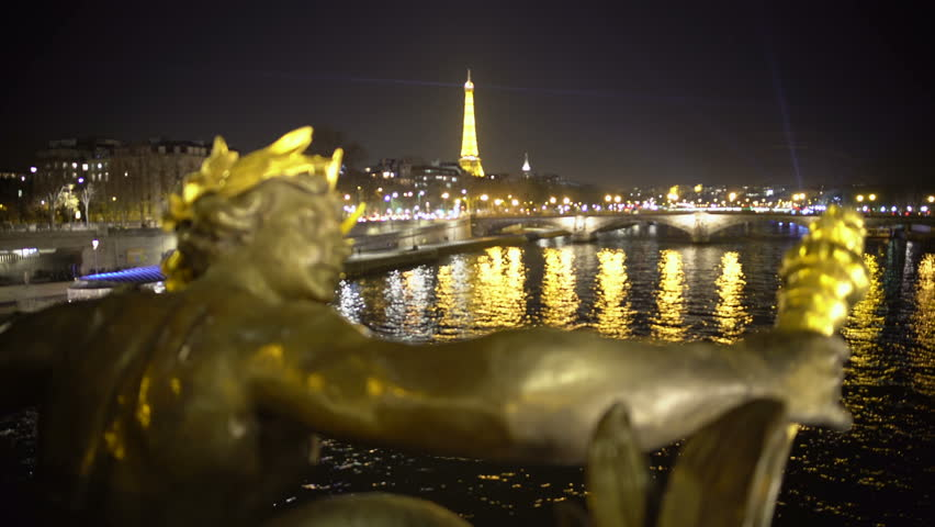 View of Paris cityscape from Pont Alexandre, Eiffel Tower sparkling at night - 4K stock video clip