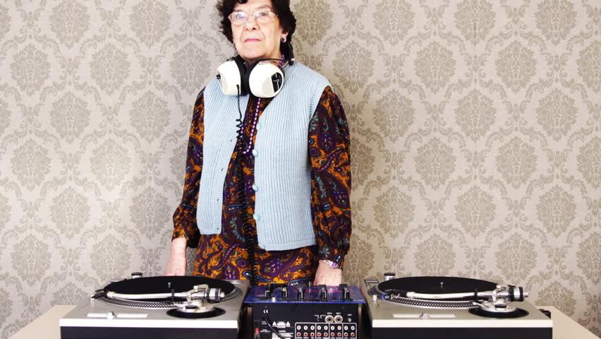 a very funky elderly lady dj, spinning records!!