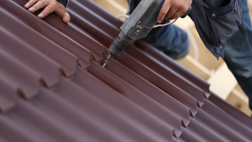workers install metal roofing - HD stock video clip