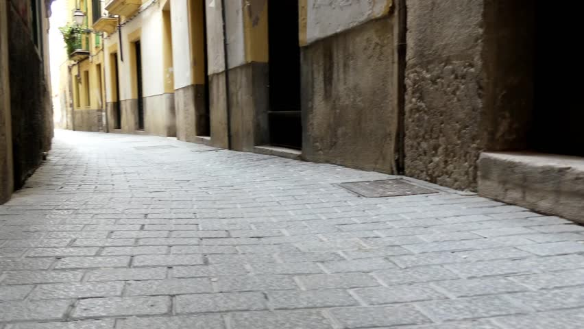 Old narrow street of Palma. Palma is the capital and largest city of the autonomous community of the Balearic Islands in Spain. It is situated on the south coast of Majorca on the Bay of Palma. - HD stock video clip