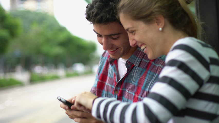 Buenos Aires, Argentina - May 06, 2016: Couple looking at smartphone together | Shutterstock HD Video #16991359