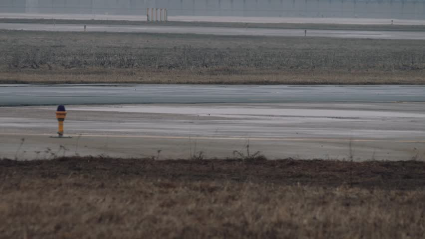 Wheels and turbines of an airbus a320 moving on a runway in the airport. Close up view, Fog weather, 4k UHD 2160p - 4K stock video clip
