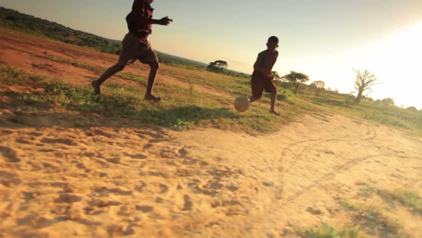 KENYA, AFRICA - CIRCA AUGUST 2010: Children playing soccer on the fields in