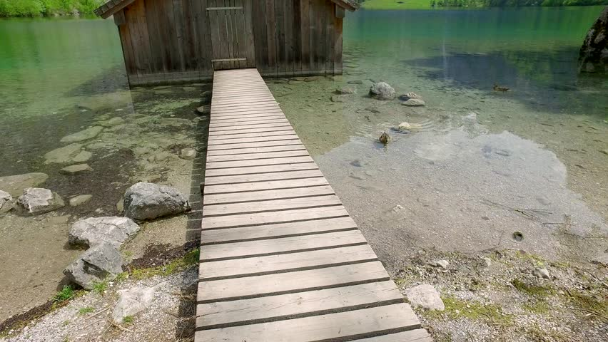 Beautiful mountain lake Obersee with wooden cottage, Alps - 4K stock footage clip