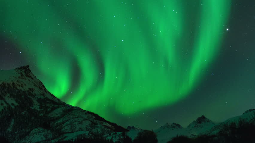 Time lapse clip of Polar Light or Northern Light (Aurora Borealis) in the night sky over the Lofoten islands in Norway in winter. Cinemagraph clip. #17067859