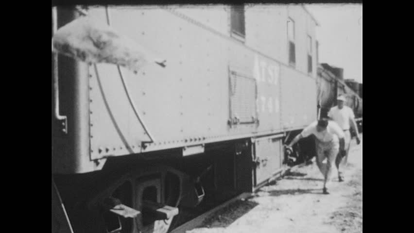 UNITED STATES 1950s: Men Check Train's Brakes and Wheels - HD stock footage clip