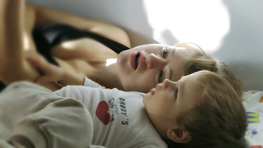 Mother and Baby Boy reading Bedtime Stories, Slow Motion