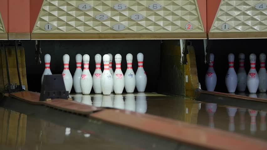 People Playing A Game Of Bowling At The Small Town Bowling