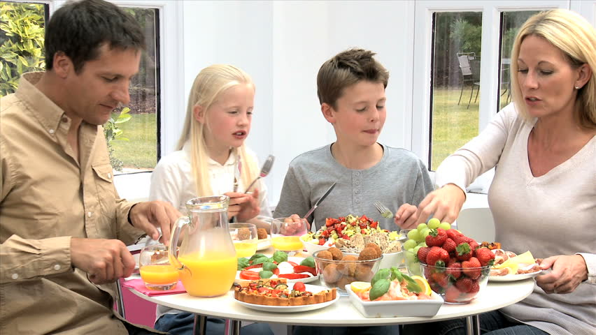 Attractive Caucasian Family Eating Together Stock Footage ...