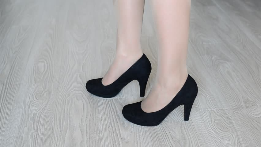 Woman takes off down a black high-heeled shoes - HD stock video clip