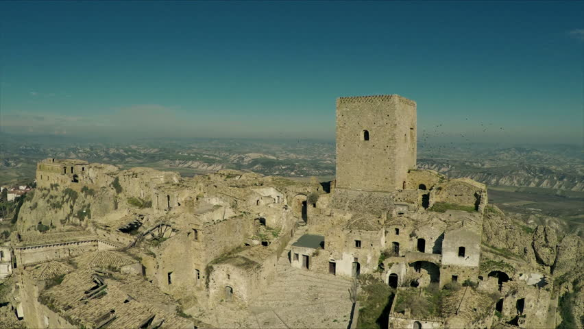 Desertic town in Italy. Craco. Aerial drone video.  N. Video about nature, desert, thorns, western, arid, water, rock, texture, loneliness, escape, Sardinia, Italy, aerial, drone. | Shutterstock HD Video #17228752
