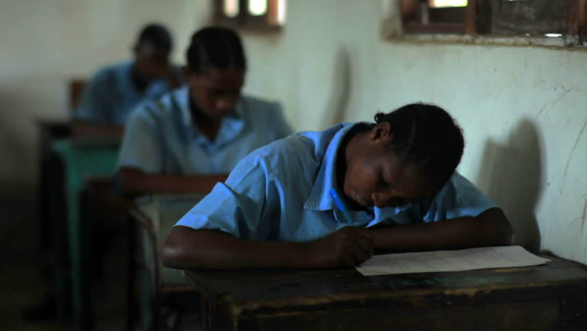 MOMBASSA, KENYA, AFRICA - CIRCA 2011: Students taking a test in class in a school in a village in Kenya