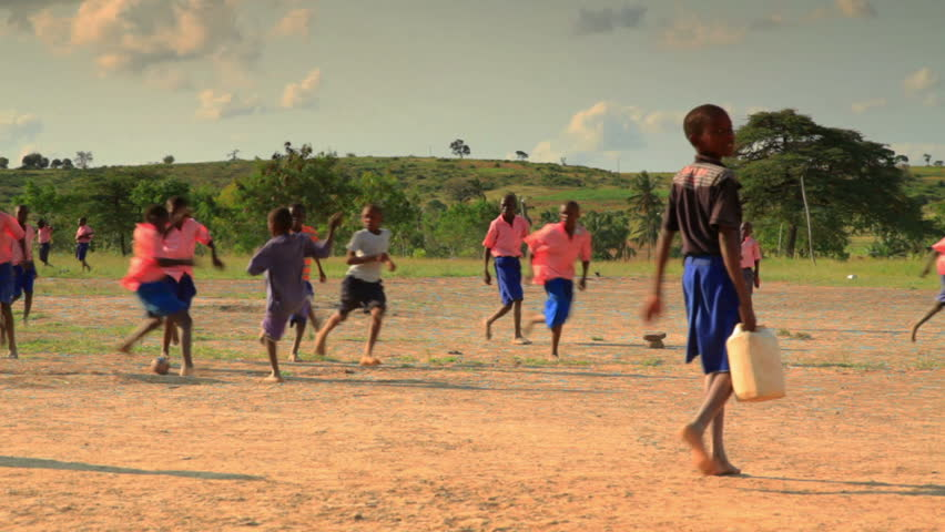 MOMBASSA, KENYA, AFRICA - CIRCA 2011: Boys playing during recess near a village in Kenya