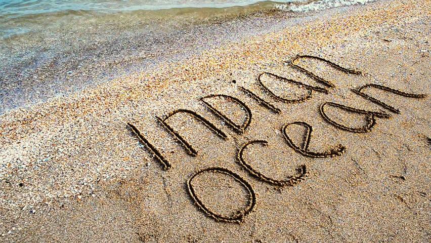 Inscription on sand the Indian Ocean. An inscription on the beach. - HD stock video clip