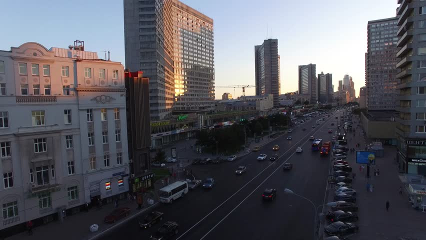 New Arbat street from above flight over. Aerial drone Moscow city center. Old Soviet and Modern buildings. Road traffic. Sunset. | Shutterstock HD Video #17268235