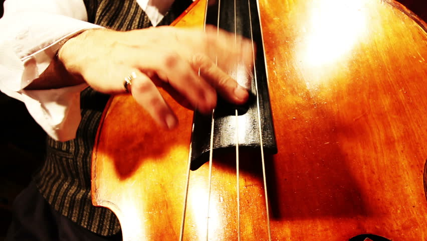Musician and Double Bass playing jazz wide low angle