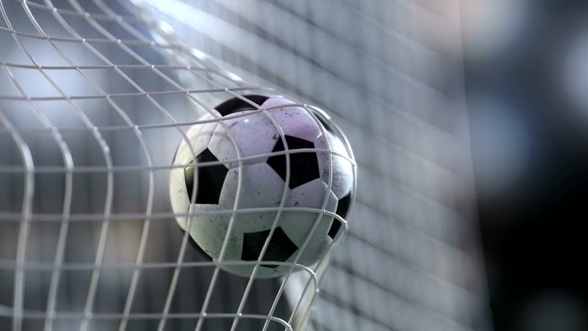 soccer ball in goal net with slowmotion. Slowmotion football ball in the net.