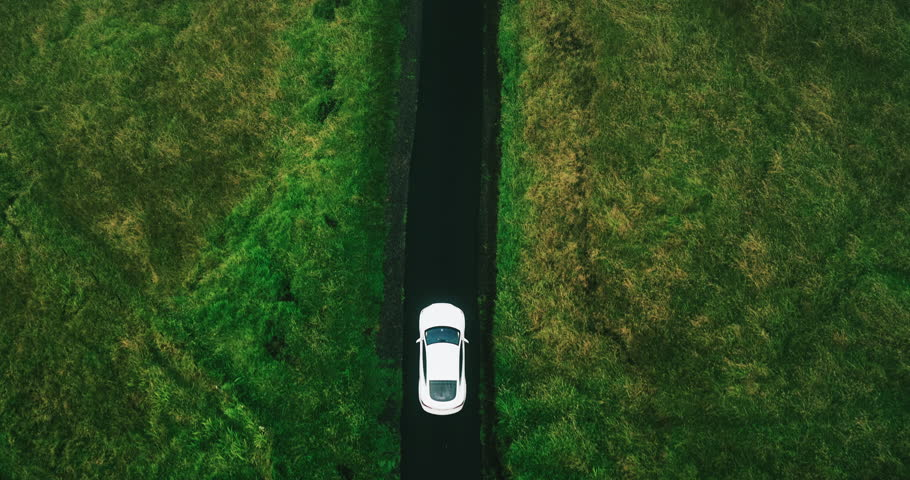 Aerial view electric car driving on country road, luxury car driving through mist at dusk with headlights | Shutterstock HD Video #17354446