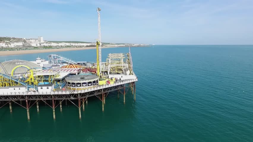 Aerial panning view of the beach in Brighton - HD stock video clip