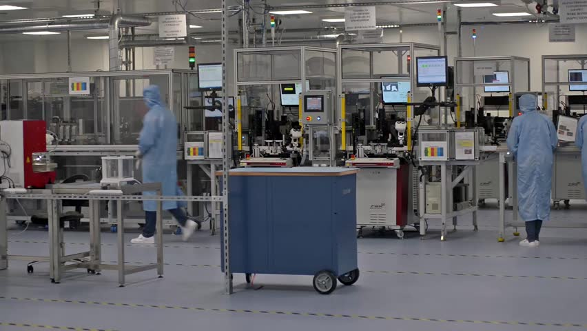 Technology specialists and assembly machines in sterile factory environment  during high-tech module and high-end component production, Plovdiv, SENSATA Bulgaria, April 08, 2016. - HD stock footage clip