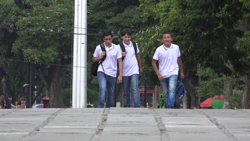 Teen Students Walking With Backpacks