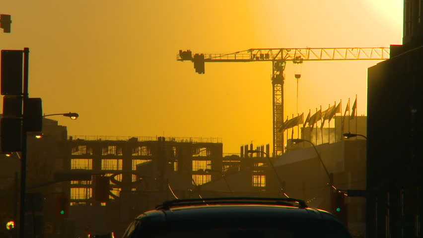 TORONTO, CANADA - SEPTEMBER 22, 2010: setting sun with construction crane silouhetted on September 22, 2010 in Toronto, Canada | Shutterstock HD Video #1745278