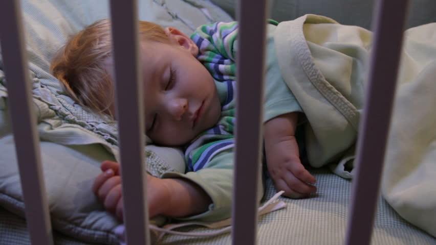 baby boy sleeping, camera dolly - HD stock footage clip