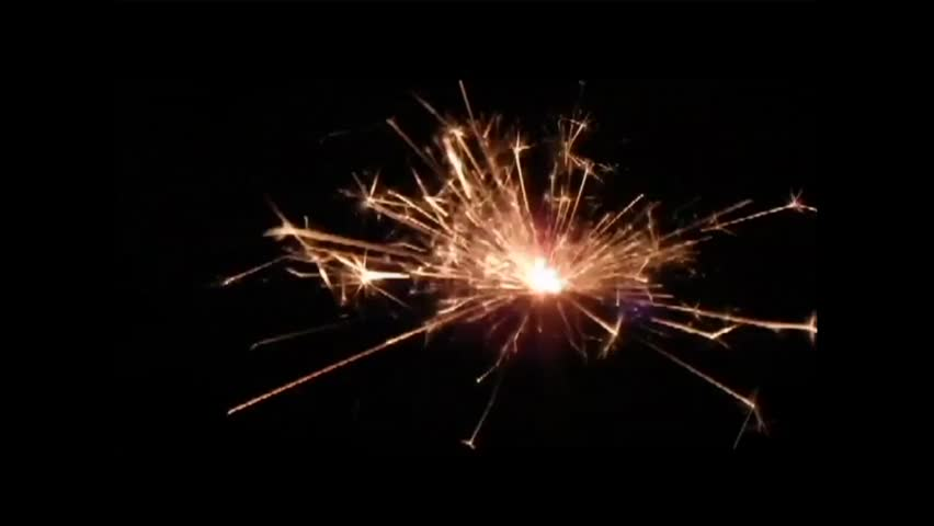 Golden sparkler on a black background with feyverkom - HD stock footage clip