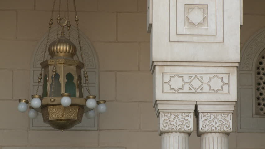 Dubai, UAE - circa 2016 - CU of Islamic designs on a capital and columns and an antique style brass lantern outside the Jumeirah Mosque. (Dubai, UAE - 2016)