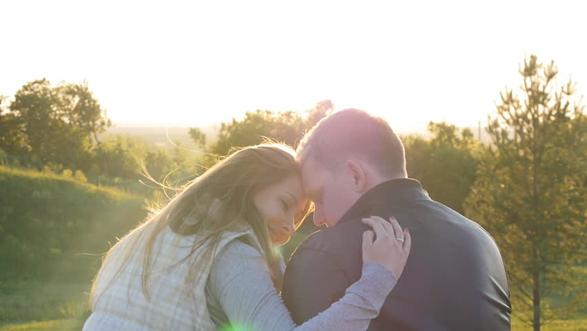 Back view of young happy couple sitting at sunset | Shutterstock HD Video #17543671