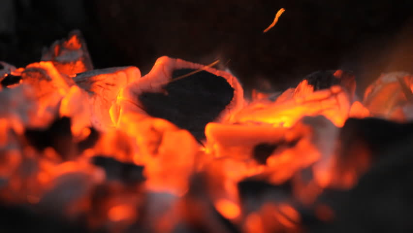 Burning Wooden Barbecue Fanning campfire embers close up - HD stock footage clip
