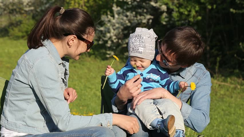Young Family Located in a Green Garden - HD stock footage clip