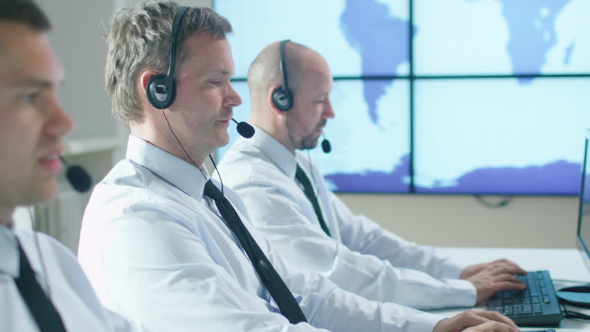 Team of Customer Support Professional in Call Center Office. Shot on RED Cinema Camera in 4K (UHD).