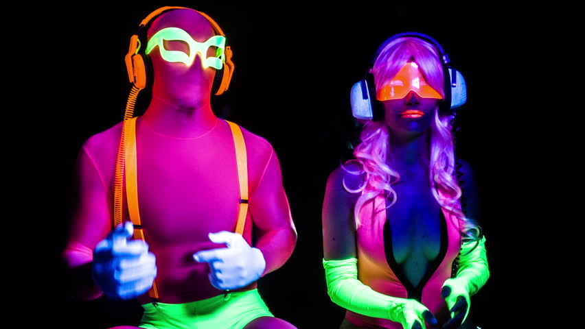 Fantastic video of sexy cyber raver man and woman filmed in fluorescent clothing under UV black light | Shutterstock HD Video #17575045