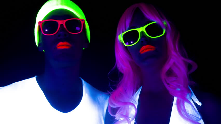 Fantastic video of sexy cyber raver man and woman filmed in fluorescent clothing under UV black light | Shutterstock HD Video #17575117
