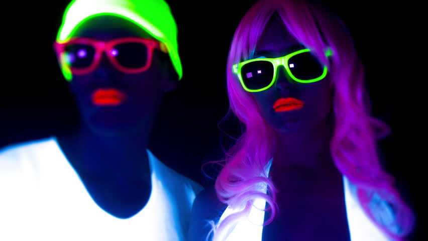 Fantastic video of sexy cyber raver man and woman filmed in fluorescent clothing under UV black light | Shutterstock HD Video #17575126