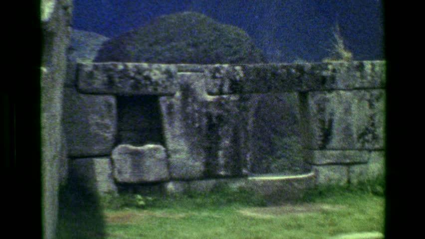CUSCO, PERU 1977: Stone monoliths Machu Picchu native Inca civilization building architecture focus ruins.