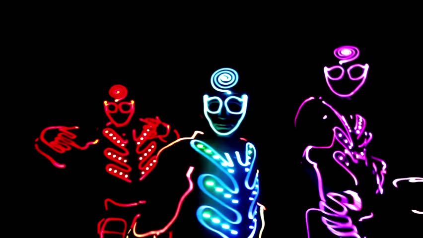 4 people dancing in costumes of LEDs  | Shutterstock HD Video #17635930